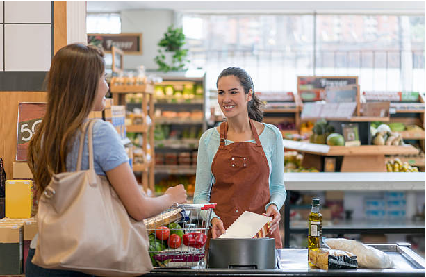 Grocery store with 2 women smiling at each other